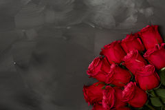 Composition of red roses on dark grey background. Romantic shabby chic decor. Top view. Love Concept. Valentines day. Roses with Gift box and pink ribbon on Stock Photos