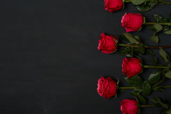Composition of red roses on dark grey background. Romantic shabby chic decor. Top view. Love Concept. Valentines day. Roses with Gift box and pink ribbon on Royalty Free Stock Photo