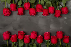 Composition of red roses on dark grey background. Romantic shabby chic decor. Top view. Love Concept. Valentines day. Roses with Gift box and pink ribbon on Royalty Free Stock Photography