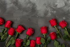 Composition of red roses on dark grey background. Romantic shabby chic decor. Top view. Love Concept. Valentines day Royalty Free Stock Photos