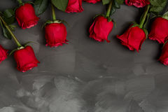 Composition of red roses on dark grey background. Romantic shabby chic decor. Top view. Love Concept. Valentines day. Roses with Gift box and pink ribbon on Royalty Free Stock Images