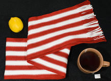 Composition with red-white scarf. Lemon and teacup Royalty Free Stock Images