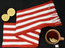 Composition with red-white scarf. Lemon and teacup Stock Photography