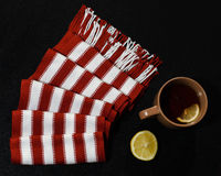 Composition with red-white scarf. Lemon and teacup Royalty Free Stock Photo