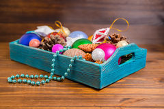 Composition of retro wooden box with Christmas decoration, tinse Royalty Free Stock Images