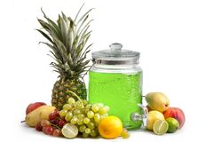 composition of ripe juicy fruits and a glass jar with lemonade. White background isolated stock photo