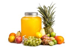 composition of ripe juicy fruits and a glass jar with lemonade. White background isolated royalty free stock image