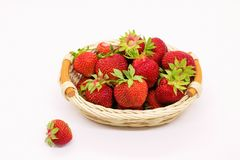 Composition of ripe strawberries on a white background in a wicker basket stock photo