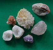 A Composition of Rock Crystal gemstones on Black, collection of Colours and Shapes royalty free stock image
