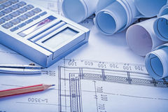 Composition rolled blueprints calculator pencil Royalty Free Stock Photo
