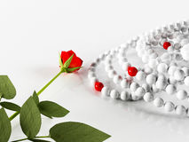 Composition with a rose and the necklaces Stock Photos