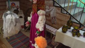 Composition of Russian folklore ,the doll in Russian folk costume,furnace.  stock video