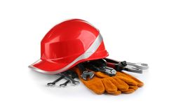 Composition with safety equipment and construction tools. On white background stock photo