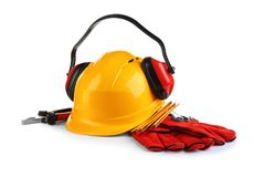 Composition with safety equipment and construction tools. On white background stock image