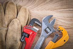 Composition of safety gloves adjustable spanner monkey wrench pi Stock Images