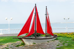 The composition 'Sailboat' on Gelendzhik promenade. Sculpture Assol and landscape composition Sailboat created based on the novel by Alexander Grin Scarlet Sails stock photo