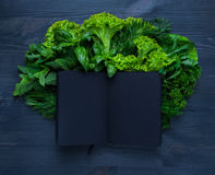 Composition with salad and notebook Royalty Free Stock Photo