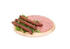 Composition of sausages on wooden platter. Royalty Free Stock Photography
