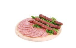 Composition of sausages on wooden platter. Royalty Free Stock Photo