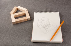 Composition of scetchbook, notepad and pencil on grey background Royalty Free Stock Photo