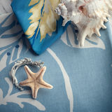 Composition with sea shells and a starfish set on cotton towels Stock Photo