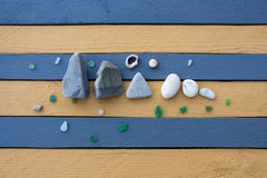 The composition of sea stones, glass and shells Stock Images