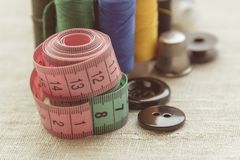 Composition of seamstress, tailor, thread for sewing and for knitting royalty free stock photos