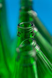 Composition of the seven green beer bottles. Royalty Free Stock Photo