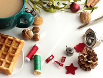 Composition of sewing accessories, snacks and holiday decoration on white surface royalty free stock photos