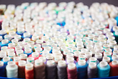 Composition of Sewing Spools. Bunch of colorful sewing spools on table in atelier, closeup stock photo