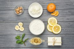 Composition with shea butter and ingredients for homemade cream. On table Royalty Free Stock Images