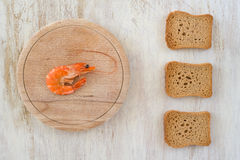 composition with a shrimp and rusks Stock Images