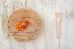 Composition with a shrimp and wooden fork Stock Photo