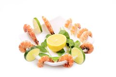 Composition of shrimps and lime. Royalty Free Stock Photo