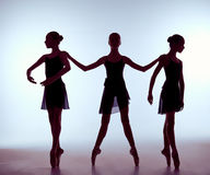 Composition from silhouettes of three young ballet Royalty Free Stock Photography