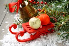 composition with sleigh, pinecone and bell Royalty Free Stock Photo