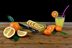 Composition with sliced citrus and glass of orange juice stock images