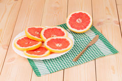 Composition of sliced grapefruit on tablecloth. Royalty Free Stock Photography
