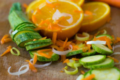 Composition of sliced oranges, courgettes, carrots and leek Stock Photography
