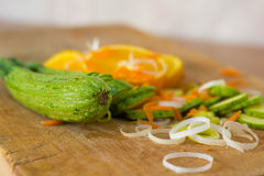 Composition of sliced oranges, courgettes, carrots and leek Stock Image