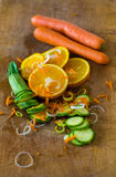 Composition of sliced oranges, courgettes, carrots and leek Royalty Free Stock Photos