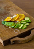 Composition of sliced oranges, courgettes and leek Royalty Free Stock Photography