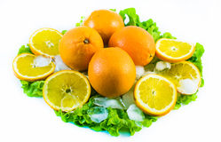 Composition of sliced oranges with ice and salad on a white background Stock Photo