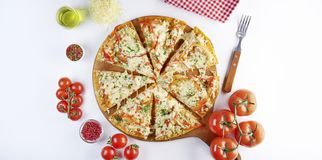 Sliced pizza with ingredients on white background. Top view, flat lay with copy space stock photos