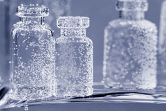 Composition with small glass bottles and bubbles Royalty Free Stock Photography