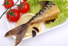 Composition from a smoked mackerel on a plate Stock Photography