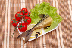 Composition from a smoked mackerel on a plate Royalty Free Stock Image