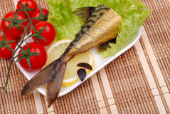 Composition from a smoked mackerel on a plate Royalty Free Stock Photography