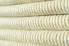 Composition of a soft yellow knitted sweater. Macro texture of bindings in yarns.  Royalty Free Stock Image