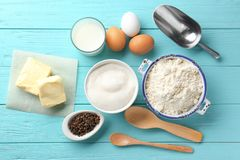 Composition with some products for cooking vanilla cake. On wooden background stock image